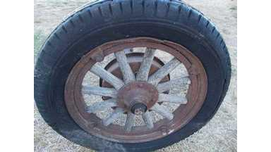 2 Old Truck Axles With Wood Spoke Wheels